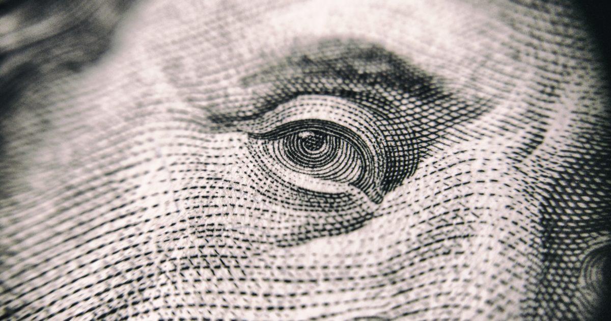 eye from dollar bill very close up