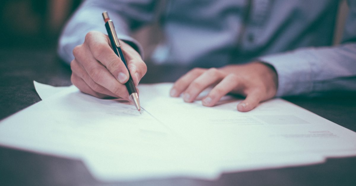 hand writing signing contract