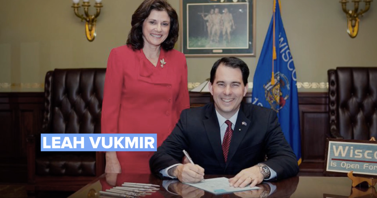leah vukmir standing next to scott walker