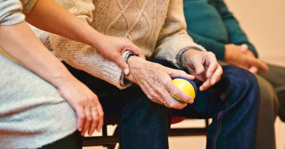 hands of senior elderly person holding ball